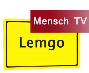 """Ortsschild Lemgo mit Aufschrift """"Mensch TV"""""""